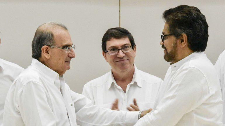 El negociador del gobierno y el de las FARC