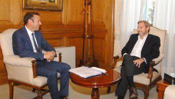 Omar Gutiérrez y el ministro del Interior, Rogelio Frigerio, en un encuentro que se hizo frecuente.