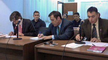 Los tres efectivos policiales en la audiencia en la que fueron acusados.