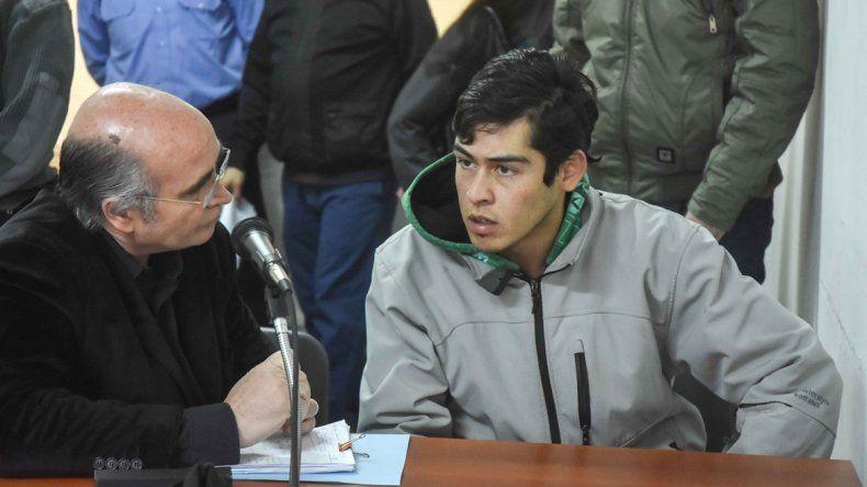 El abogado Gustavo Palmieri y el acusado del crimen
