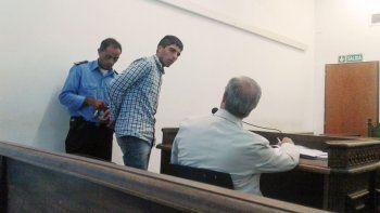 Julio Aroca, en la audiencia de formulación de cargos, junto a su defensor.