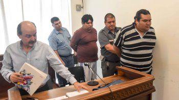 Carlos y Cristian Burgos ayer en la audiencia de formulación de cargos.