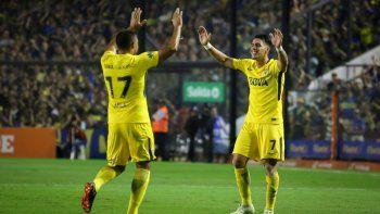 Las dos figuras de la noche: Cristian Pavón, un gol y asistencia, y Wanchope Ábila, doblete. Juntos la rompen.
