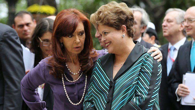 CFK, junto a Dilma y Mujica, en un foro crítico
