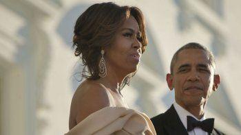 michelle admitio que habria tirado del balcon a obama