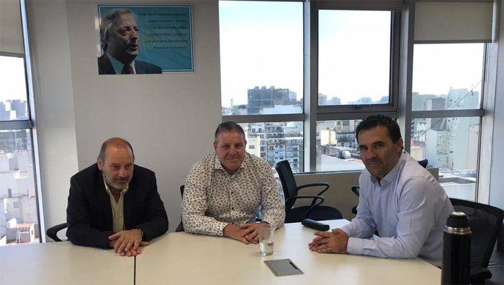 Darío Martínez con la federación de gremios petroleros