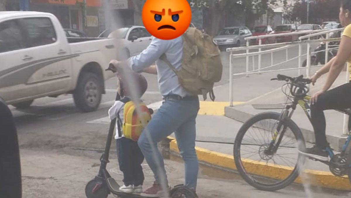 iba con su hijo en monopatin por las calles del centro de neuquen