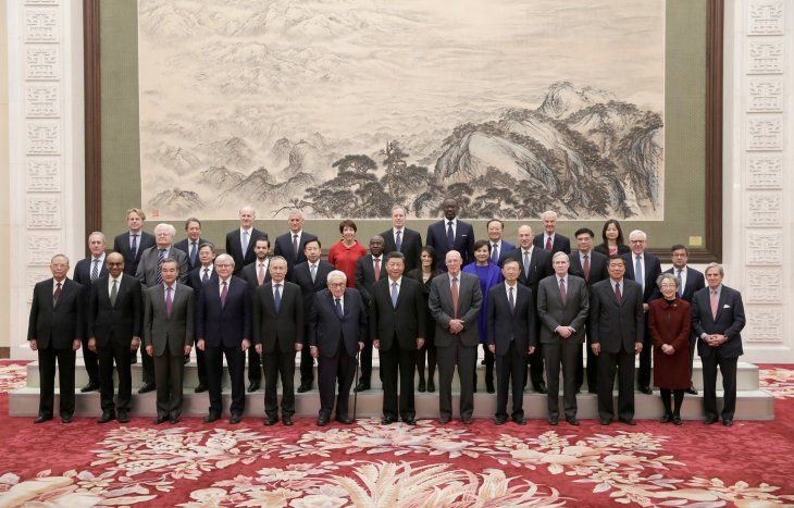 Chinese President Xi Jinping (C) and Vice Premier Liu He (5th L) attend a group photo session with former U.S. Secretary of State Henry Kissinger (left to Xi)