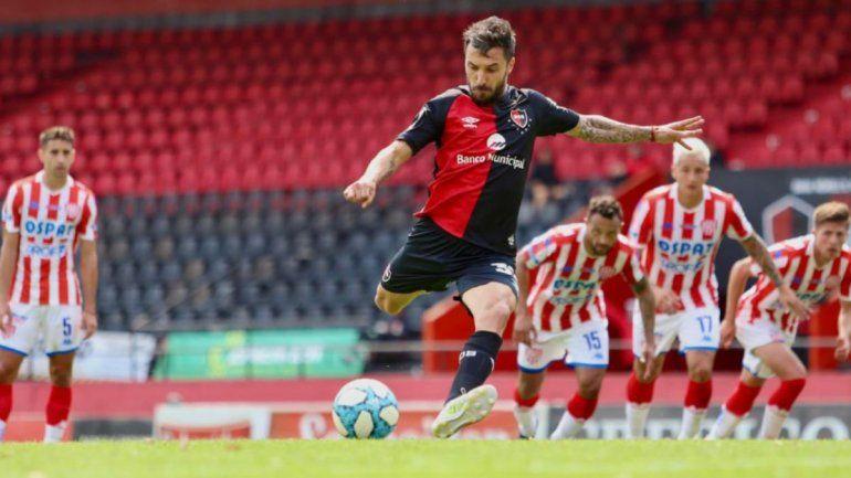 Nacho Scocco anotó de penal el 1-1 definitivo.